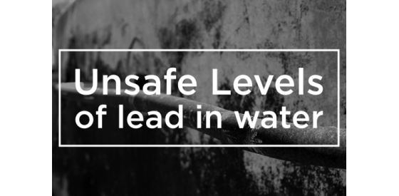"White writing of ""unsafe levels of lead in water"" imposed above an old black and white photo of a lead pipe"