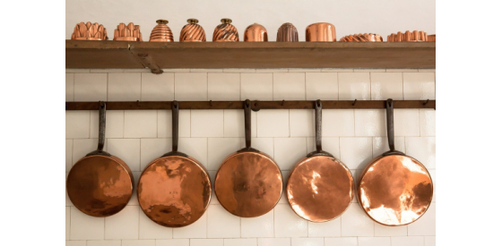 Copper pans hanging on wall