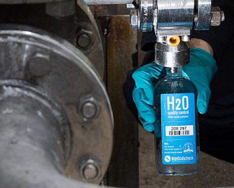 H2Olabcheck Sampling Bottle, Industrial equipment in the backgroung
