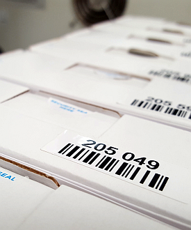 Envelopes with a tracking number used to manage water testing results