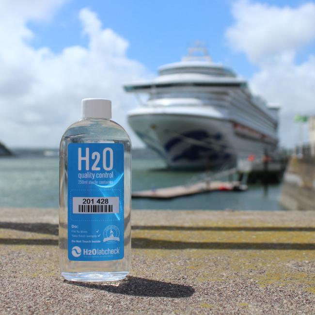 sampling H2O bottle, ship behind