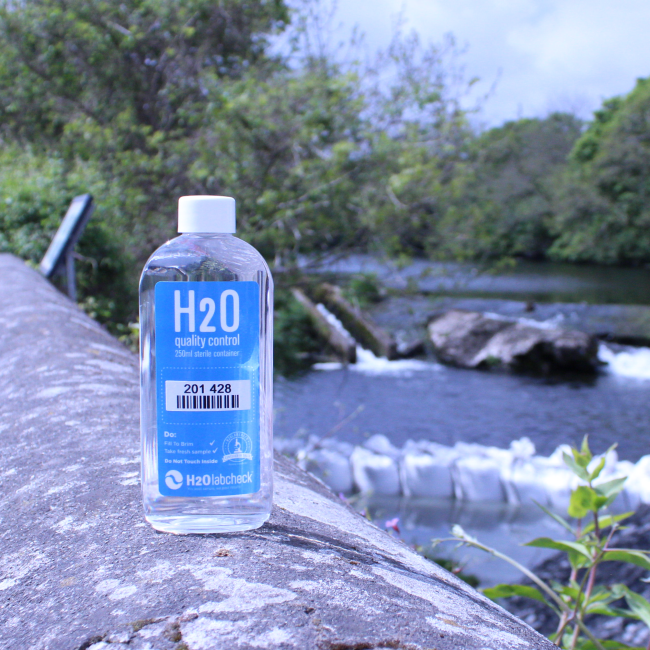 H2O labcheck sampling kit, river in the background