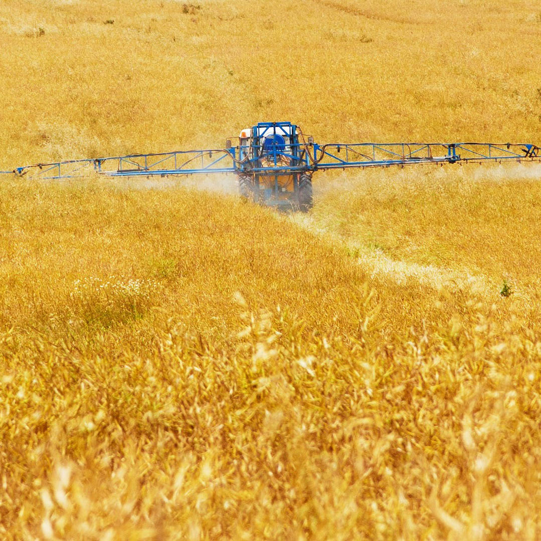 tractor spreading fertilizer